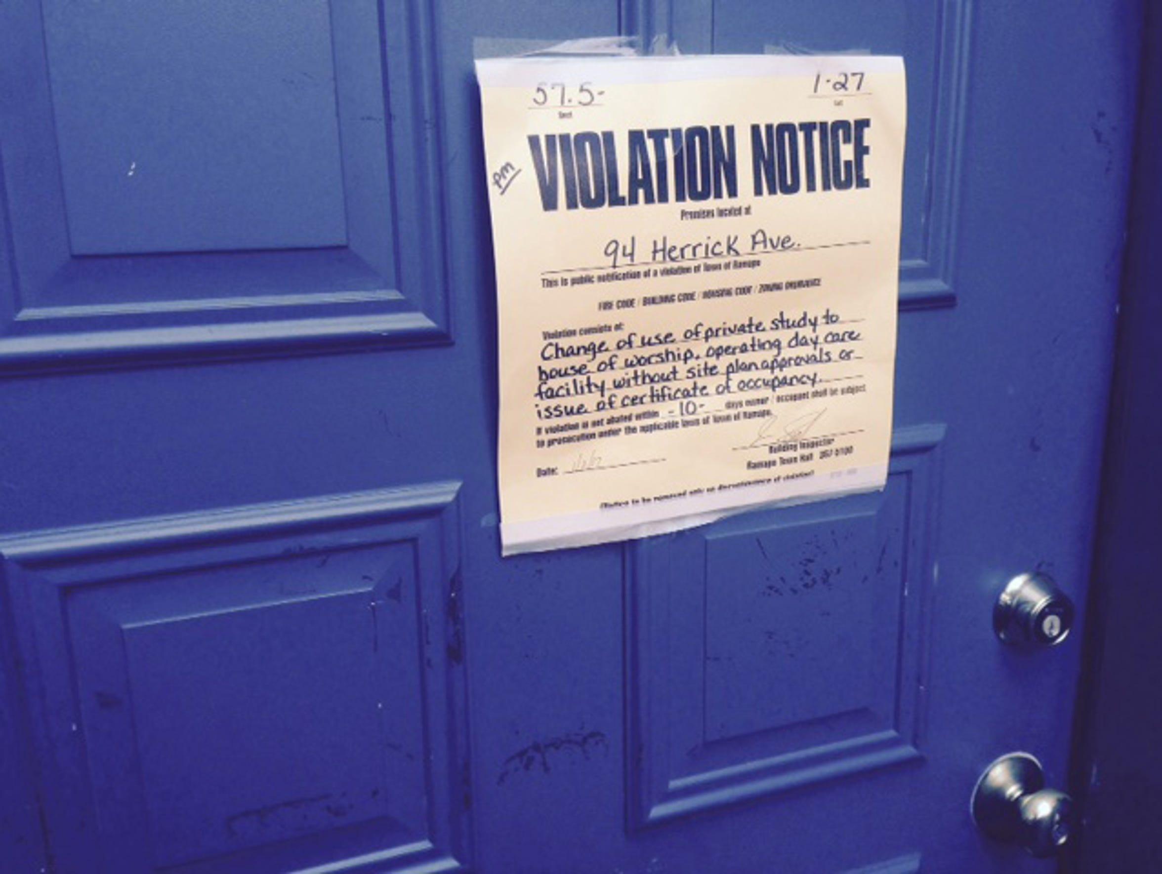 Ramapo violation notice posted on the door of 94 Herrick