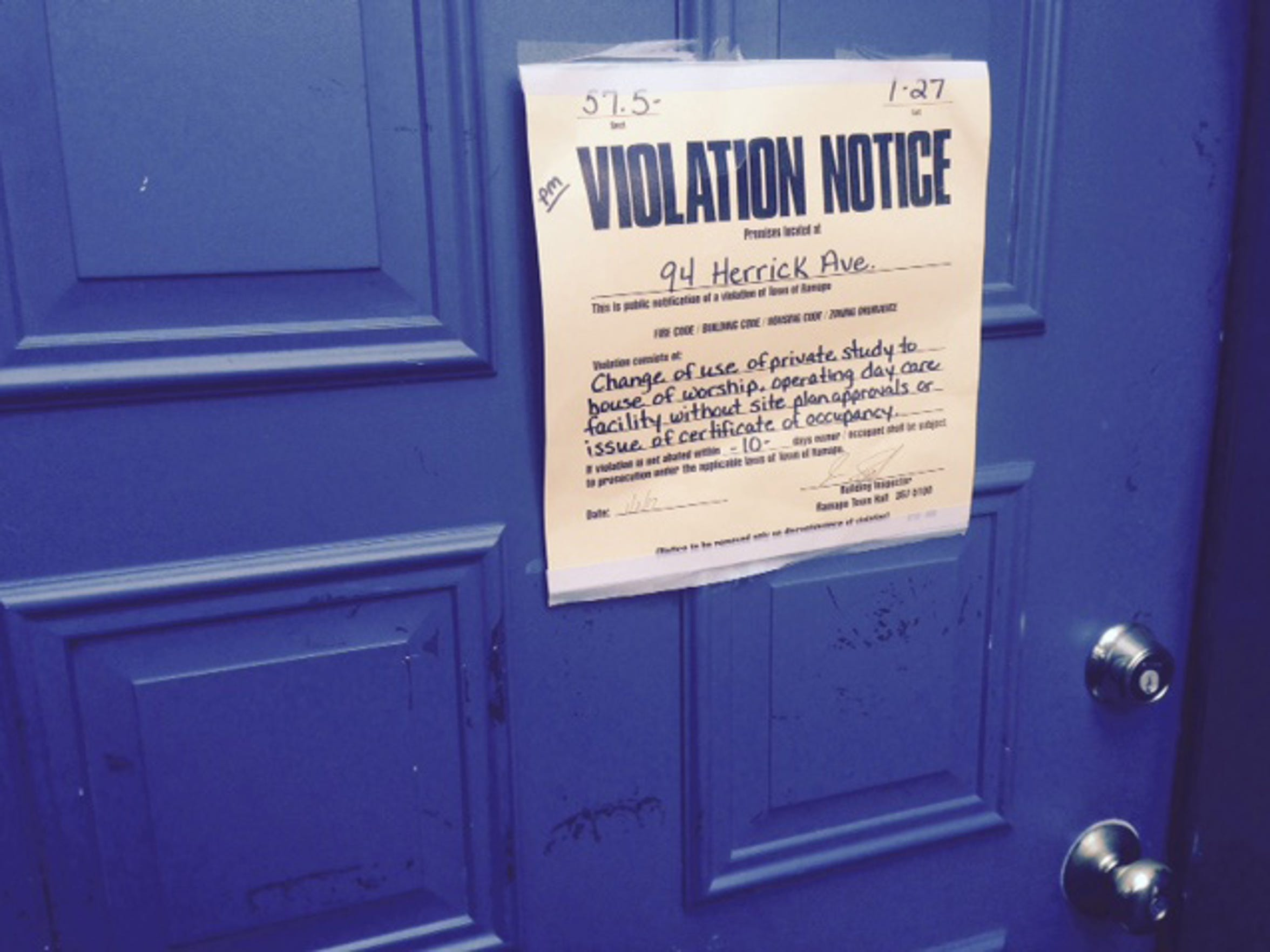 Ramapo violation notice posted on the door of 94 Herrick