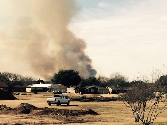 Smoke erupts from a controlled burn in San Angelo State