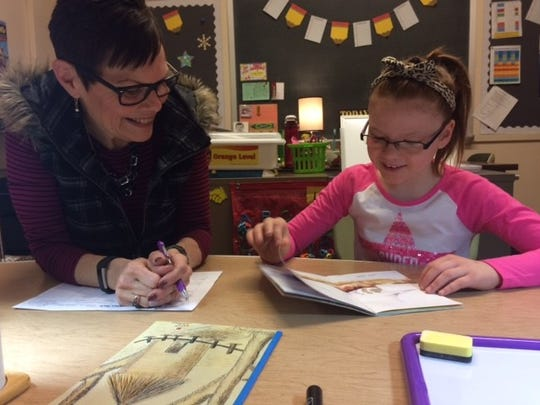 Cindy Smith, a reading specialist, works with Waters