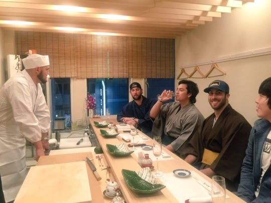 Anthony Bass eats sushi with his teammates.