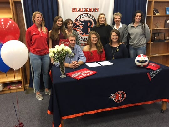 Blackman's Maddie Lee recently signed a volleyball