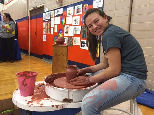 Alyn Dobrosky demonstrates pottery-making during Millville