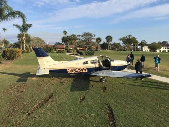 A small airplane makes an emergency landing Saturday at a golf course in Stuart.