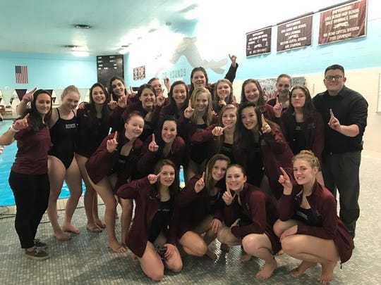 Shippensburg's girls swimming team celebrates after