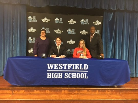 Westfield's Owen Kessler (left) and Liz Brucia sign their National Letters of Intent on Wednesday.