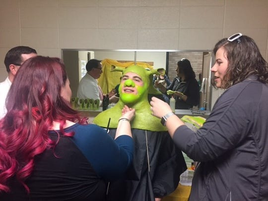 "From start to finish, it can take almost three hours to get Northland Lutheran High School senior Jacob Price into costume to play the character ""Shrek."""
