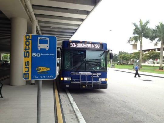 A  LeeTran bus stops at Southwest Florida International Airport's passenger terminal.