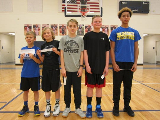 Boys winners and their age groups are, (l to r), Garret Shouse (9), Morganfield; Jack Maloney (11), Morganfield; Nathan Baird (12), Henderson; Andrew Chandler (13), Henderson and Kale Gathier (14), Morganfield. Not pictured is Evan Farley (10), Henderson.
