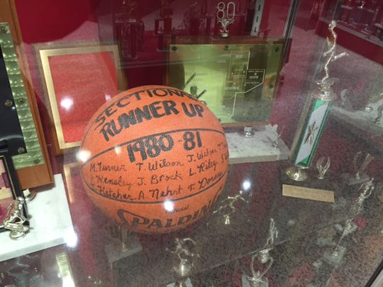 An awards display case commemorates a 1980-81 sectional runner-up finish.