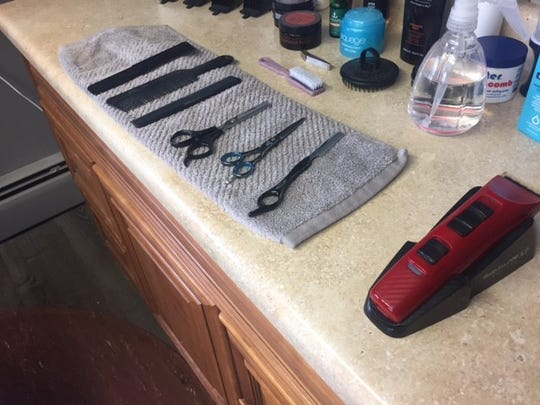 Maggie Theil's tools include a straight razor for shaves-