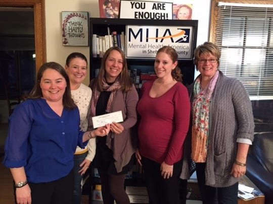 The Sheboygan Service Club presents a check to Mental Health America. Pictured, from left to right: Mary Lovelien (SSC), Andrea Igowsky (SSC), Kate Baer, Trisha Erpelding, and Laura Albright.