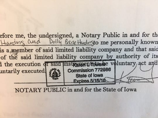 Karen Towers' notary stamp and signature on the contract home sale for which she received a commission.