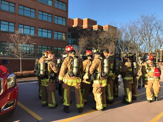 Firefighters outside Kellogg Co. headquarters, where a freon leak was discovered Saturday.