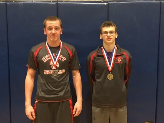 Gavin Wills, left, took second at 170 pounds in the District 5 Class AA wrestling tournament, while Liam Flaherty, right, won the 132 title. Both are Southern Fulton students who wrestle for Everett via a co-op program.