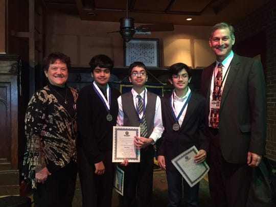 Optimist Club president Roxanne Fitzpatrick (from left) with middle school winners Sanjiv Seshan, Tejas Maire, Yash Mehta  and Farmington Public Schools Superintendent George C. Heitsch.