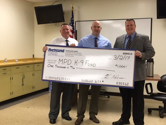 Richland Bank donation to MPD K-9 vest.JPG