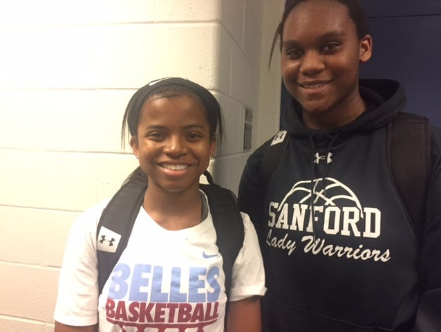 Sanford's Lauren Park (left) and Samantha Pollich played key roles in a 53-50 win over Conrad.