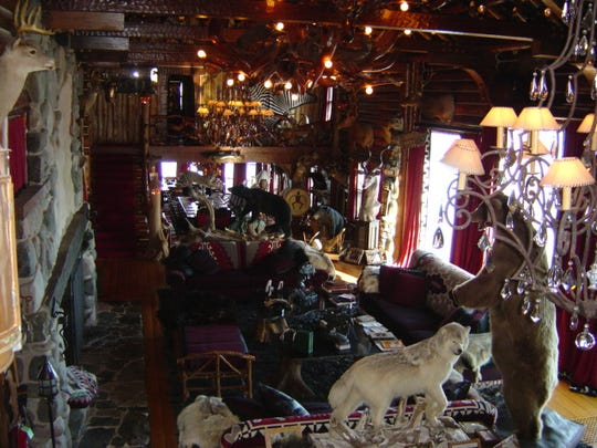A view of the Great Room, which is 60 feet long and lighted by a chandelier carved from a massive tree root.