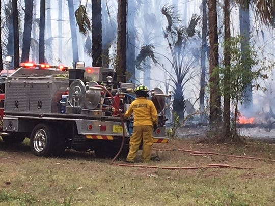 Firefighters battled a 4-acre brush fire that was threatening homes in Golden Gate Estates on Monday, March 13, 2017.