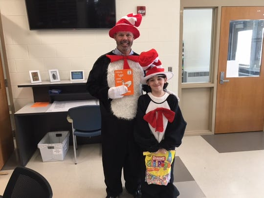 At Howe Elementary School, Wayne Knutson, director of elementary student services, and fifth-grader Eddie Stanley Bonilla celebrated Dr. Seuss's birthday on March 2 by reading to classrooms.