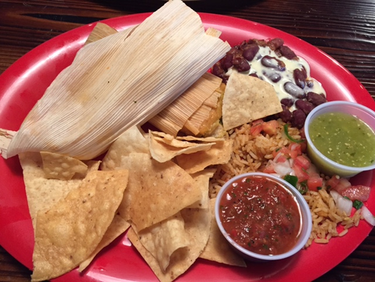 Sokno Taco Cantina Serves A Fried Cornmeal Wred Tamale Platter That Comes With Fiesta Rice And Cast Iron Beans Kidney Infused House
