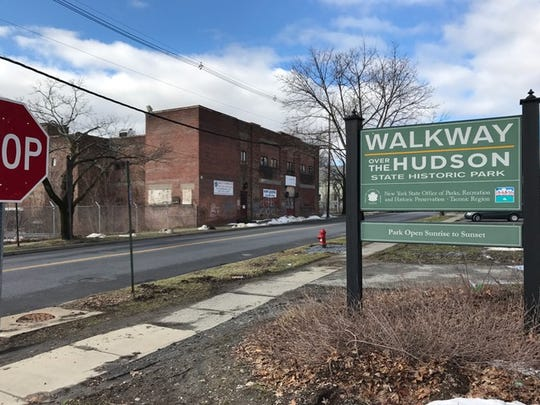 Joseph Spiezio bought 58 Parker Ave. in Poughkeepsie in 2010 hoping he could turn it into the centerpiece of a vibrant new neighborhood near the entrance to the Walkway Over the Hudson. Beset by protracted litigation, the grafitti-covered warehouse building remains vacant.