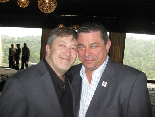 Eric Bauman (right) and his husband, Michael Andraychak.
