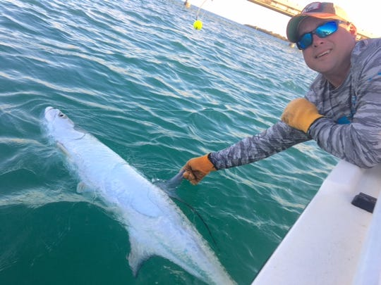 One of 11 different tarpon the Evans' hooked up with