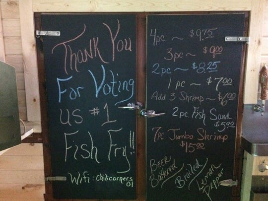 A sign behind the bar at Chili Corners Bar & Grill thanks customers for voting them the No. 1 fish fry in the Marshfield area in a recent Marshfield News-Herald survey.