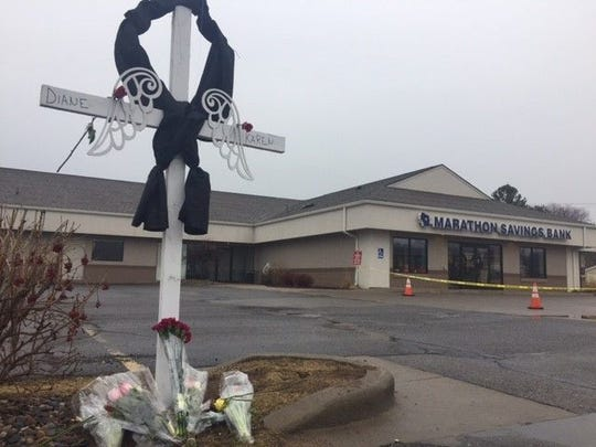 A memorial to Dianne M. Look, 67, and Karen L. Barclay, 62, is set up outside the Marathon Savings Bank in Rothschild. The women were killed in a March 22 shooting spree.