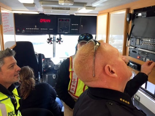 Ruidoso Police Chief Darren Hooker checks a communications