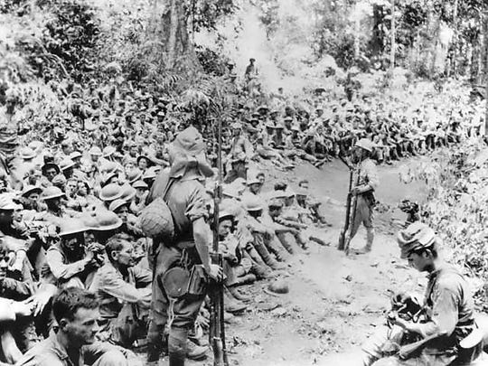 Troops rest during the Death March from Bataan to the
