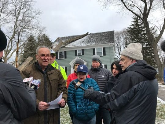 Sen. Charles Schumer, D-N.Y., on a visit to a damaged house in Irondequoit after the windstorm in March.