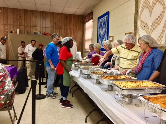 Volunteers helped serve an Easter meal to local homeless