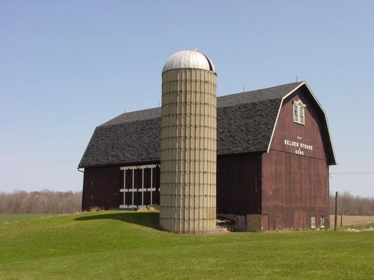 An important piece of Wheatland history is the story of the Wells barn. John Talcott Wells Sr. was granted a patent for his arched truss design in 1889. The Wells family firm used the design to build nearly two hundred barns in New York, Ohio, Pennsylvania and Canada. This photograph shows their last Wells barn, built in 1942 on the Stokoe Farm near Scottsville.
