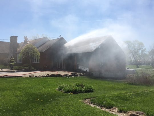 Barney and Carol Jaeger of 5781 Ohio 19 were alerted their garage and then house were on fire by a passing by motorist Tuesday. The couple's house and garage in Crawford County was heavily damaged. Galion Fire Chief Phil Jackson said the cause of the fire remains under investigation.
