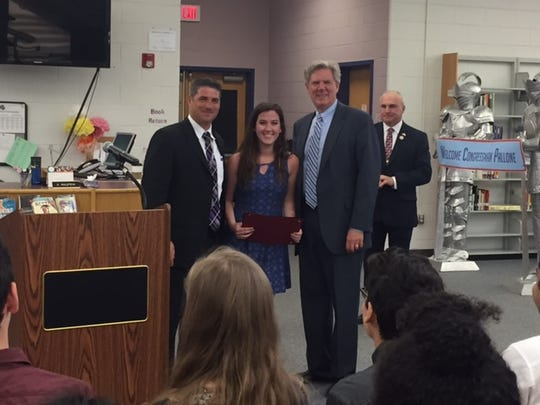 left to right:  OBHS Principal Vincent Sasso, Caitlin Ellis-Foster senior at OBHS, Congressman Frank Pallone Jr., and Old Bridge Mayor Owen Henry  looking on.