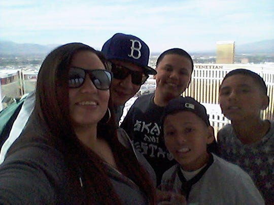 Angel Ortiz, 32, poses for a photo with his family.