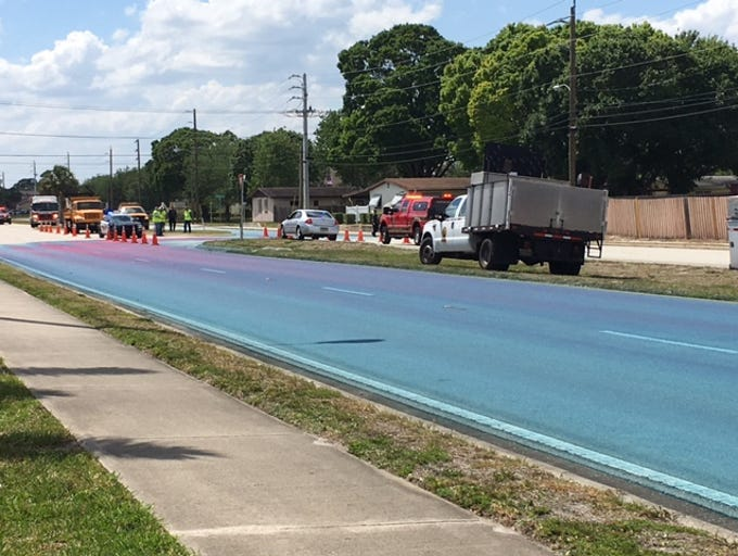 Spill turns Eau Gallie Boulevard blue in Melbourne.