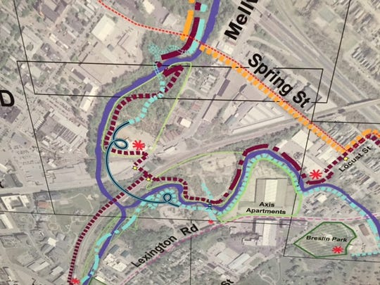 Portion of a much bigger plan showing location of potential pedestrian and bike bridge over East Main Street and the railroad tracks. The creek is shown in purple with hash-marked lines showing various trail alternatives.