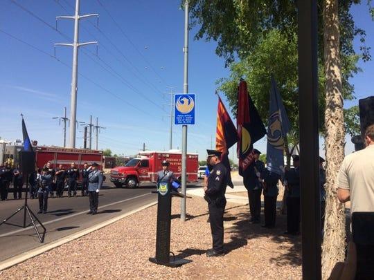 Phoenix police Sgt. Vince Lewis unveils the permanent,