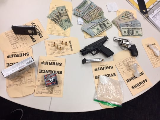 Authorities provided this photo of evidence seized in the investigation that led to the arrest of Martin Arago, 37.