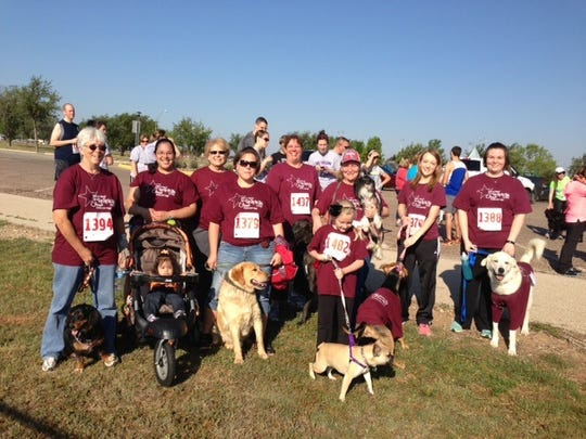 A team from Key City Veterinary Clinic pauses for a photo at a previous run for Rescue the Animals.