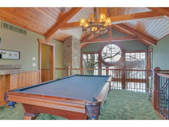 A recreation room is in the loft at 17447 Fisher Road near Cold Spring.