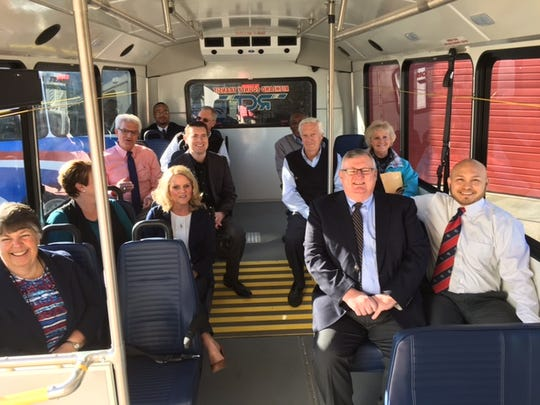 Community leaders and RCT staff take an inaugural ride on one of the five smaller RCT buses that will be on the roads in Richland County Tuesday.