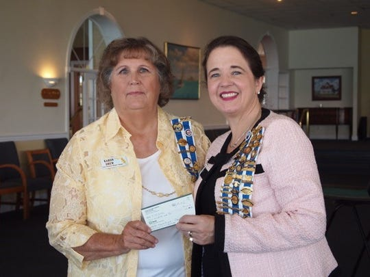 Cora Stickney Harper Chapter Regent presents a check to Florida State Society Regent-elect Dawn Lemongello for her State Regent's project.