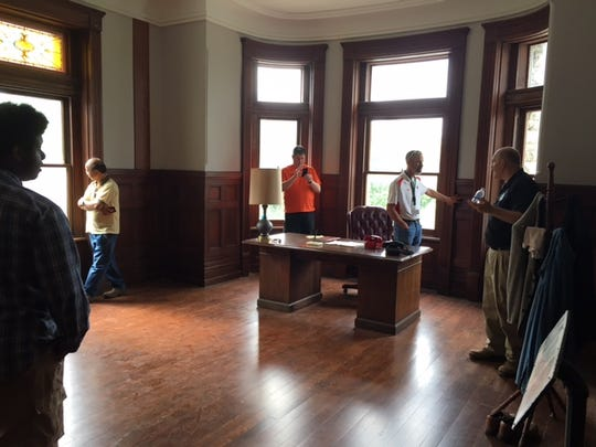 A school group tours the Shawshank warden's office.