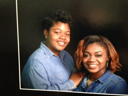 Sydney Johnson, right, and her sister, Whitney