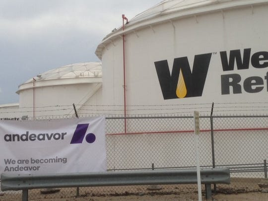 A banner with the new Andeavor logo hangs near an entrance to Western Refining's El Paso refinery. Tesoro Corp., which bought Western, will change its name to Andeavor Aug. 1.